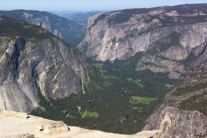 Tweeting from the top of Half Dome. Photo by Sagano